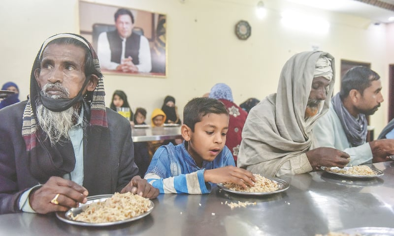FREE food is served to visitors of the Surjani Town Panahgah.—Photo by Fahim Siddiqi / White Star
