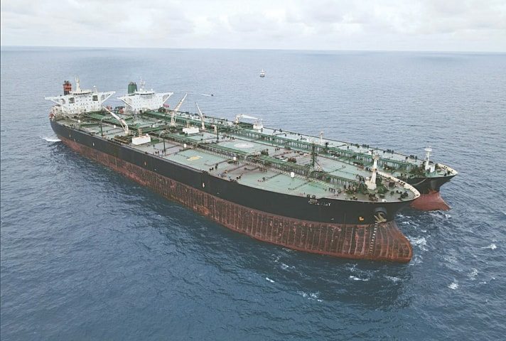 THE Panamanian-flagged (left) and Iranian-flagged tankers are seen anchored together off Borneo island.—AP