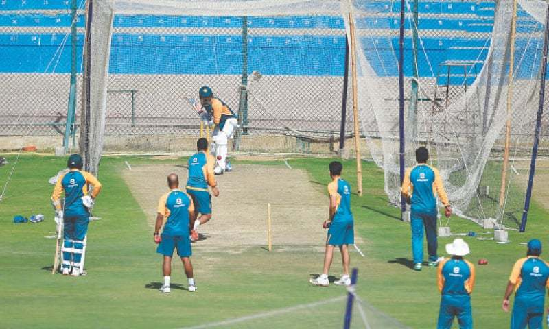 KARACHI: Pakistan players take part in a nets session at the National Stadium on Sunday.—AFP
