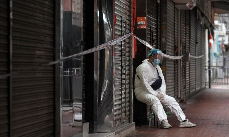 A government worker wearing personal protective equipment guards at the closed area in Jordan district, in Hong Kong, on Jan 24. — AP