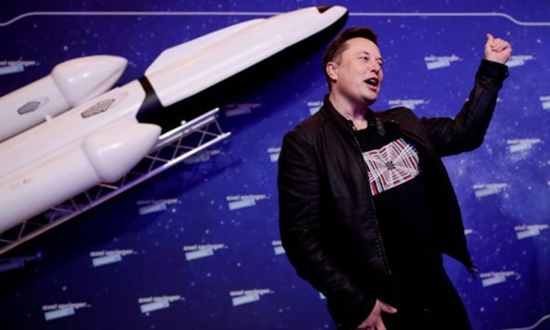 SpaceX owner and Tesla CEO Elon Musk gestures after arriving on the red carpet for the Axel Springer award, in Berlin, Germany, December 1, 2020. — Reuters