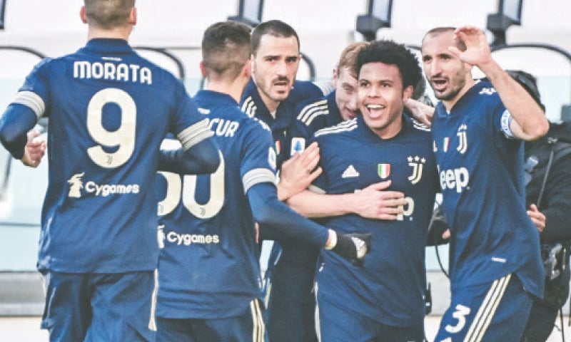 TURIN: Juventus' Weston McKennie (second R) celebrates with team-mates after scoring during the Serie A match against Bologna at the Juventus Stadium.—AFP