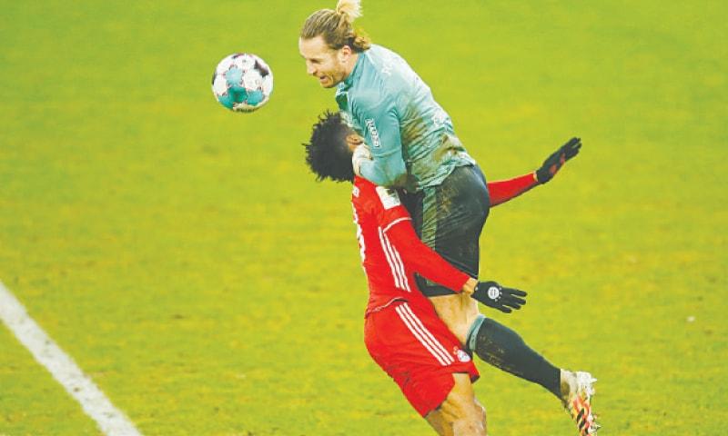 GELSENKIRCHEN: Schalke 04 goalkeeper Ralf Fahrmann collides with Kingsley Coman of Bayern Munich during their Bundesliga match at Veltins Arena.—Reuters