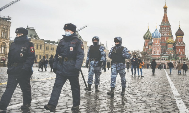 MOSCOW: Police officers and the Russian National Guard servicemen patrol the Red Square on Monday.—AFP
