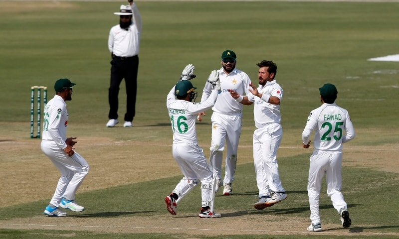 Pakistan's spinner Yasir Shah, second from right, celebrates with teammates on the dismissal of South Africa's batsman Faf du Plessis during the first day of the first cricket test match between Pakistan and South Africa at the National stadium on Jan 26. — AP