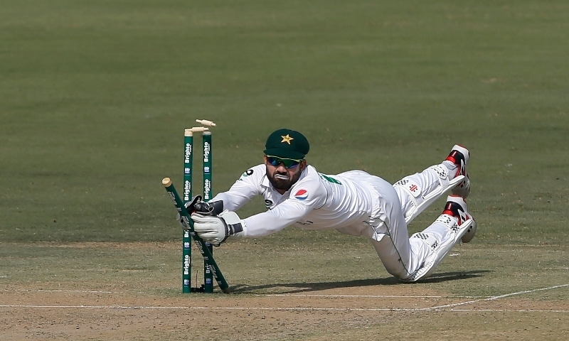 Pakistan's wicketkeeper Mohammad Rizwan shatters bails to run-out South Africa's batsman Rassie van der Dussen during the first day of the first cricket test match between Pakistan and South Africa at the National stadium on Jan 26. — AP
