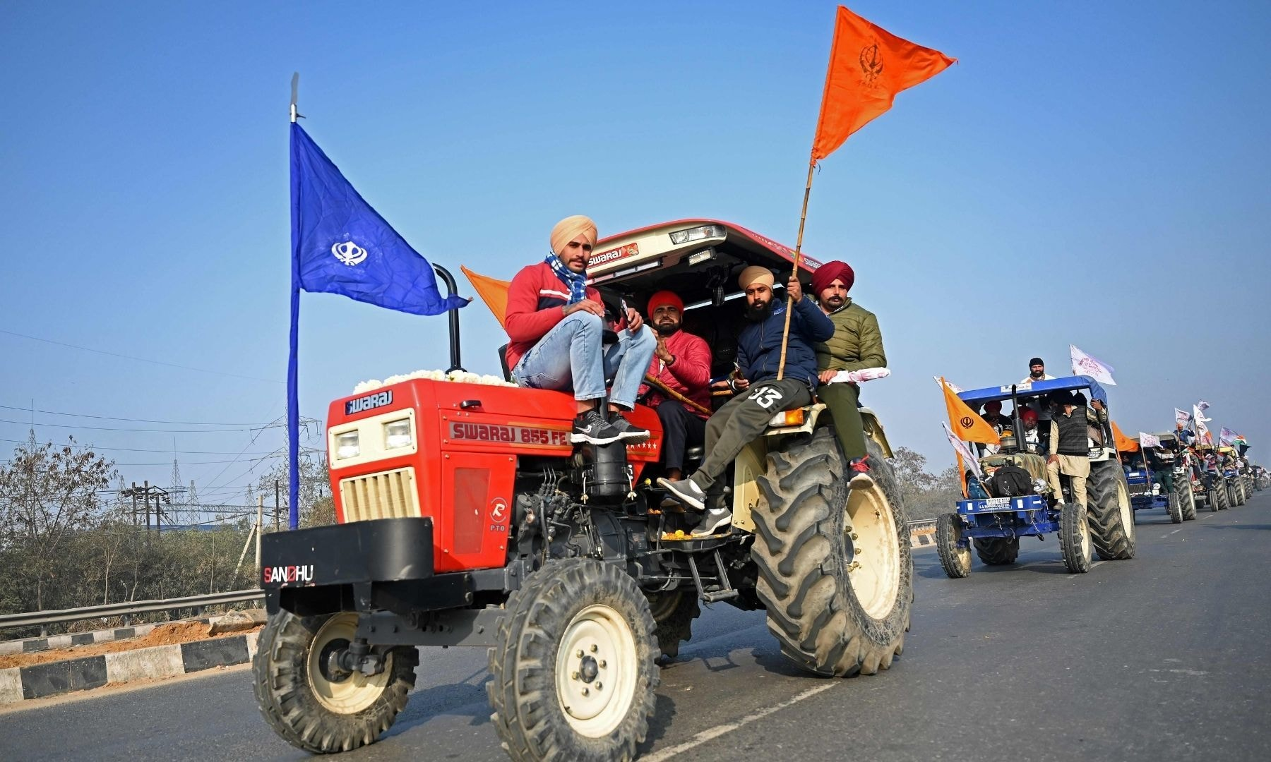 Farmers take part in a tractor rally as they continue to demonstrate against the Indian government's recent agricultural reforms in New Delhi on January 26, 2021. — AFP