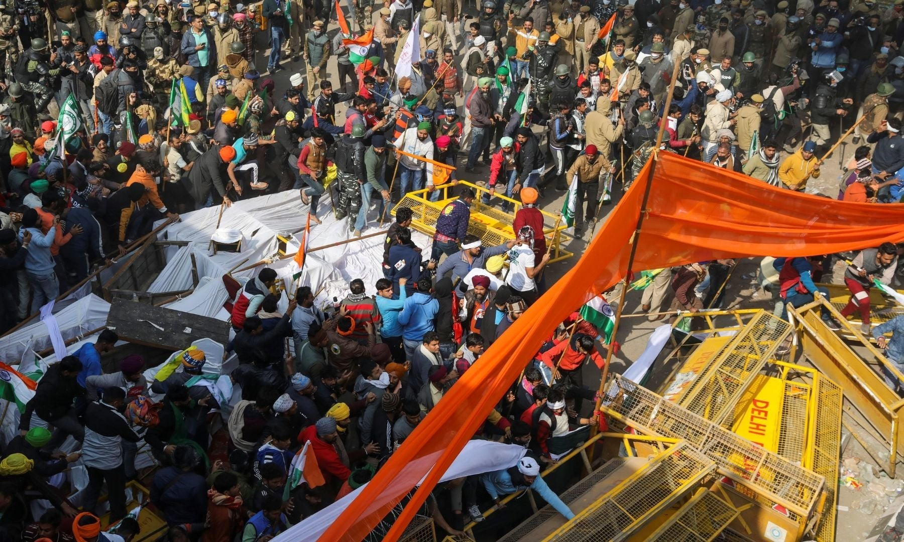 Farmers move barricades during a tractor rally to protest against farm laws on the occasion of India's Republic Day at Tikri border near New Delhi on January 26. — Reuters