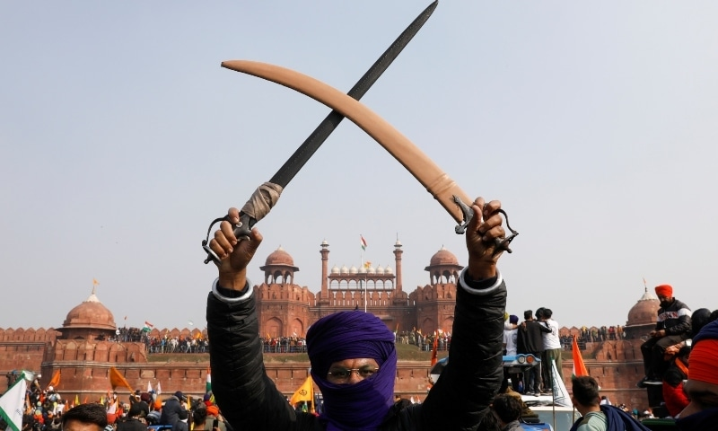 A farmer holds a sword during a protest against farm laws introduced by the government, at the historic Red Fort in Delhi, India, January 26. — Reuters