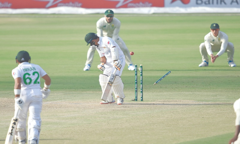 KARACHI: Pakistan opener Abid Ali is clean bowled by South African pacer Kagiso Rabada during the first Test at the National Stadium on Tuesday.—White Star/Tahir Jamal