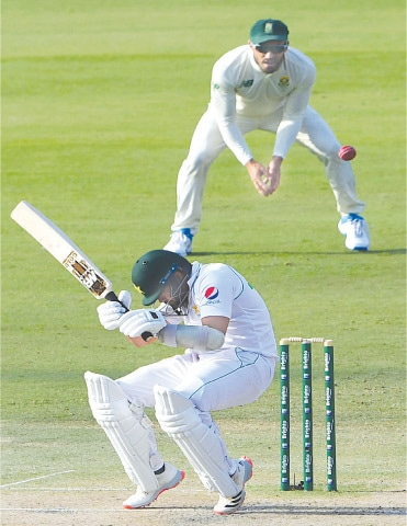 AZHAR Ali avoids a bouncer from Anrich Nortje.—AFP