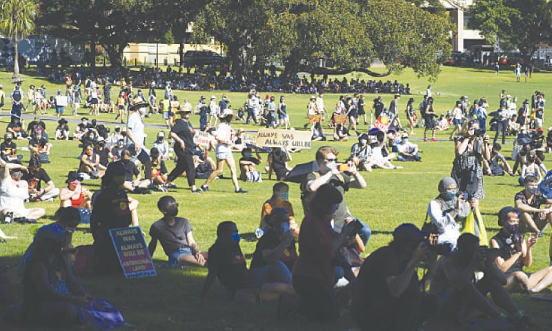 """SYDNEY: Protesters gather for an """"Invasion Day"""" demonstration to mark Australia Day on Tuesday.—AFP"""