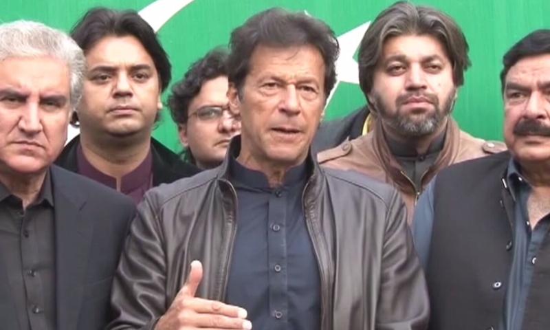 In this file photo, PTI chief Imran Khan addresses a press conference alongside Shah Mahmood Qureshi and Sheikh Rasheed. ─ DawnNewsTV/File