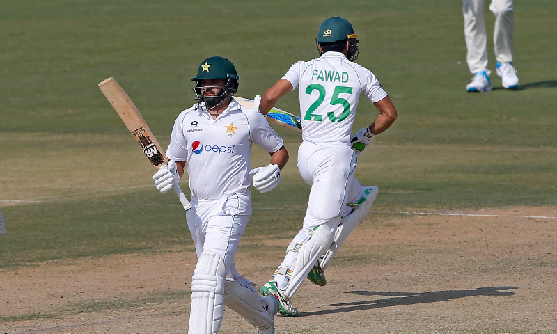 Azhar Ali, front, and Fawad Alam run between the wickets during the second day of the first Test match between Pakistan and South Africa at the National Stadium, in Karachi on Wednesday, Jan 27. — AP