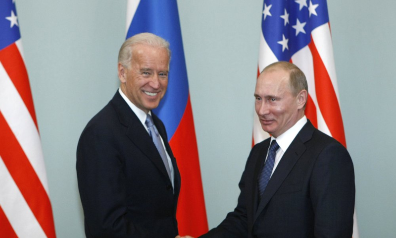 In this March 10, 2011, file photo, then-Vice President Joe Biden, left, shakes hands with Russian Prime Minister Vladimir Putin in Moscow, Russia. — AP/File