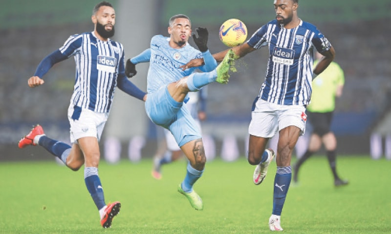 WEST BROMWICH: Manchester City's Gabriel Jesus (C) vies for the ball with West Bromwich Albion's Semi Ajayi (L) and Kyle Bartley during their Premier League match at the Hawthorns.—Reuters