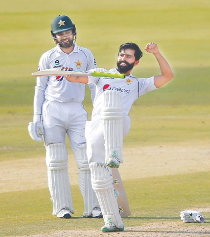 KARACHI: Fawad Alam celebrates after scoring a century while teammate Faheem Ashraf watches during the second day of the first Test match between Pakistan and South Africa at the National Stadium on Wednesday. The 35-year-old's third Test century put Pakistan in charge as he scored 109 to lead the hosts to 308-8 by the close of play — a first innings lead of 88 runs. The left-hander hit nine fours and two sixes to lift Pakistan from a precarious overnight total of 33-4. Azhar Ali and Faheem Ashraf also weighed in with half-centuries after Pakistan bowled South Africa out for 220 on the first day.—AP