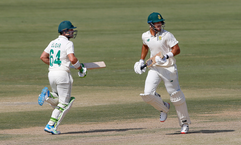 Dean Elgar, left, and Aiden Markram run between the wickets during the third day of the first cricket Test match between Pakistan and South Africa at the National Stadium in Karachi on Thursday. — AP