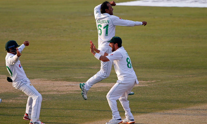 Nauman Ali, center back, and teammates celebrate after the dismissal of South Africa's Aiden Markram during the third day of the first cricket Test match between Pakistan and South Africa at the National Stadium in Karachi, Pakistan on Thursday. — AP
