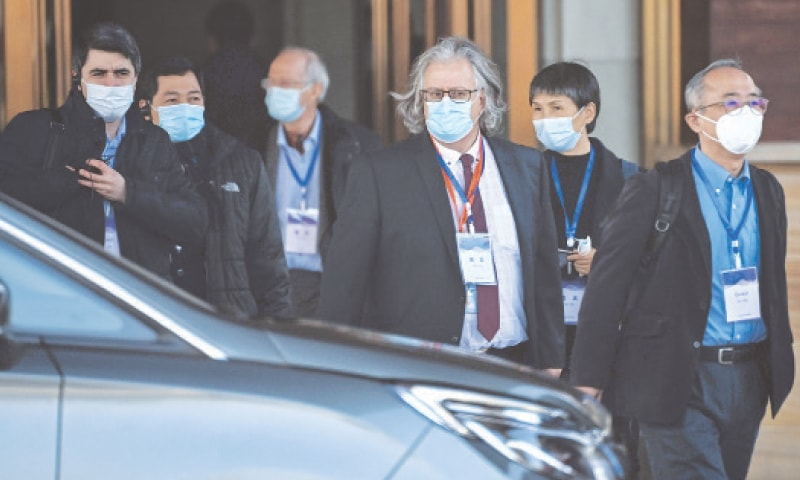 WUHAN: Members of the WHO team leave the Hilton Wuhan Optics Valley Hotel, where the team is currently based post-quarantine, on Friday.—AFP