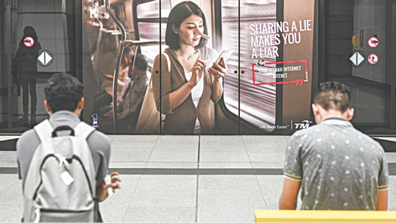 An ad in Malaysia urges people not to spread fake news | AFP