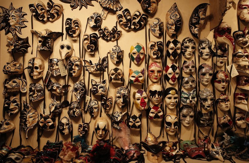 Carnival masks placed on display in a Venetian artisan mask makers shop in Venice, Italy, on Saturday, Jan 30. — All photos by AP