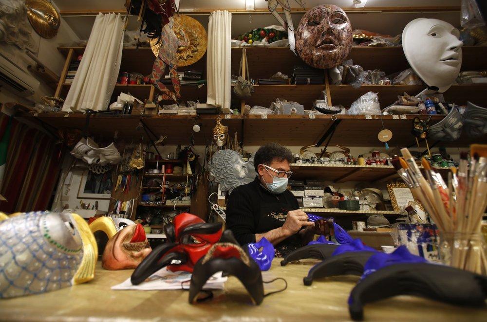 Venetian artisan mask maker Gualtiero Dall'Osto works in his workshop in Venice.