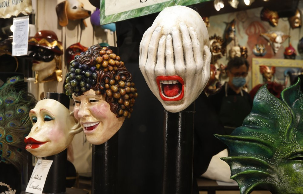 Carnival masks on display in a shop window in Venice.