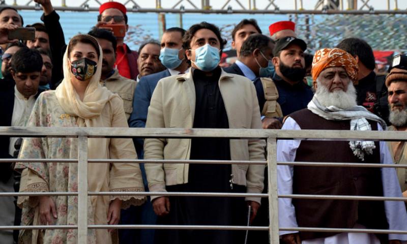 PML-N's Maryam Nawaz, PPP's Bilawal Bhutto-Zardari and JUI-F chief Maulana Fazlur Rehman attend a PDM rally in Peshawar on Nov 22. — AFP/File
