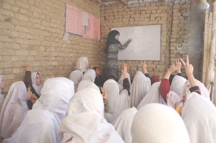 Mahbooba teaches students in a class.