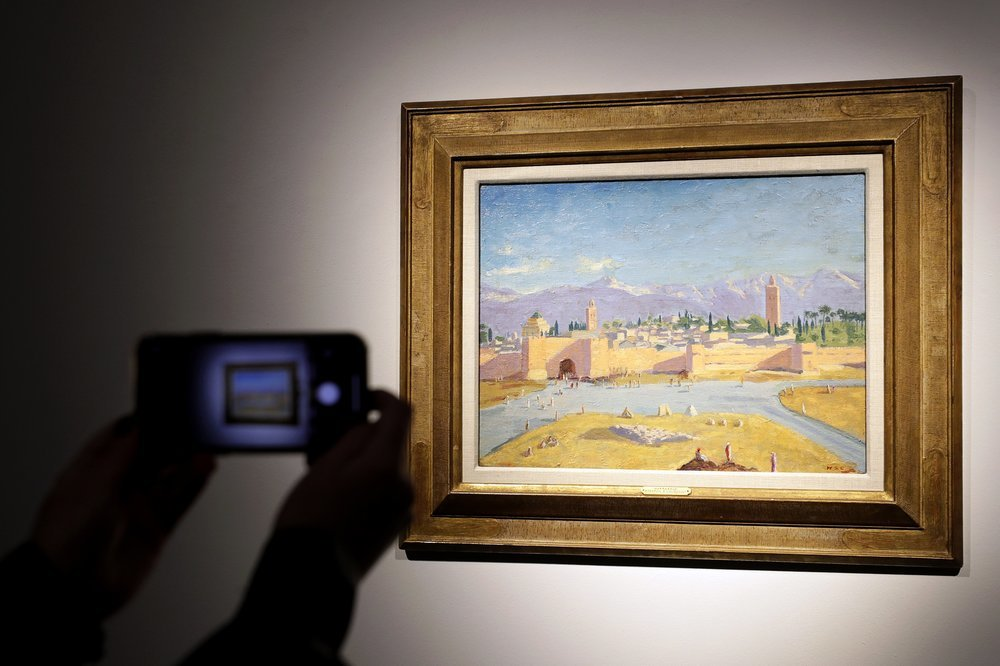 An oil on canvas painting by Sir Winston Churchill Painted in Jan 1943 called 'Tower of the Koutoubia Mosque' is displayed at Christie's auction rooms in London. — AP