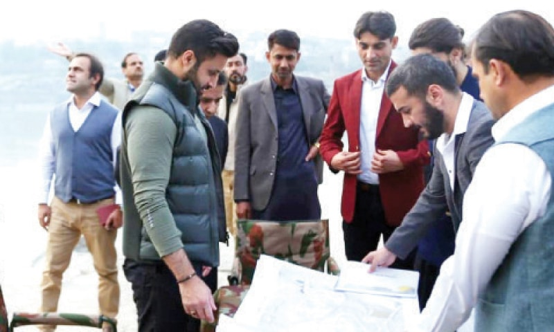 Special Assistant to the Prime Minister on Overseas Pakistanis Syed Zulfikar Bukhari being briefed on the project at Attock Fort on Monday. — Dawn