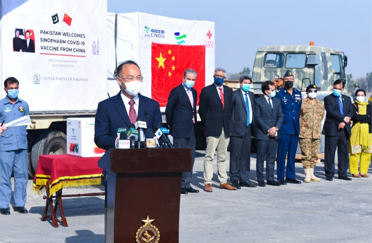 ISLAMABAD: Chinese Ambassador Nong Rong speaks at a ceremony held for handing over the first batch of Chinese vaccine to Pakistan at Nur Khan Airbase on Monday. Foreign Minister Shah Mahmood Qureshi also attended the ceremony.—White Star