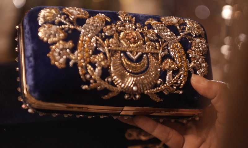Custom-made royal blue clutch to match Benazir's sapphire necklace.