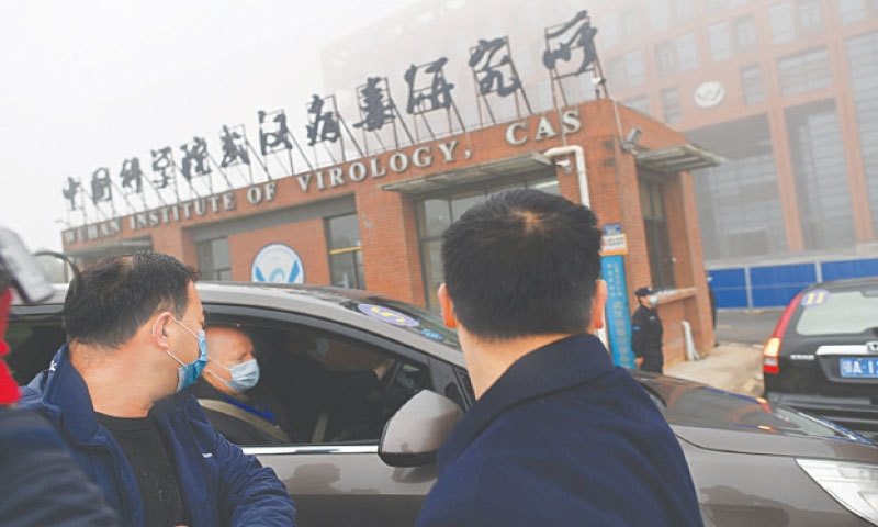 WUHAN: Members of the World Health Organisation team investigating the origins of Covid-19 arrive by car at the Wuhan Institute of Virology on Wednesday.—AFP