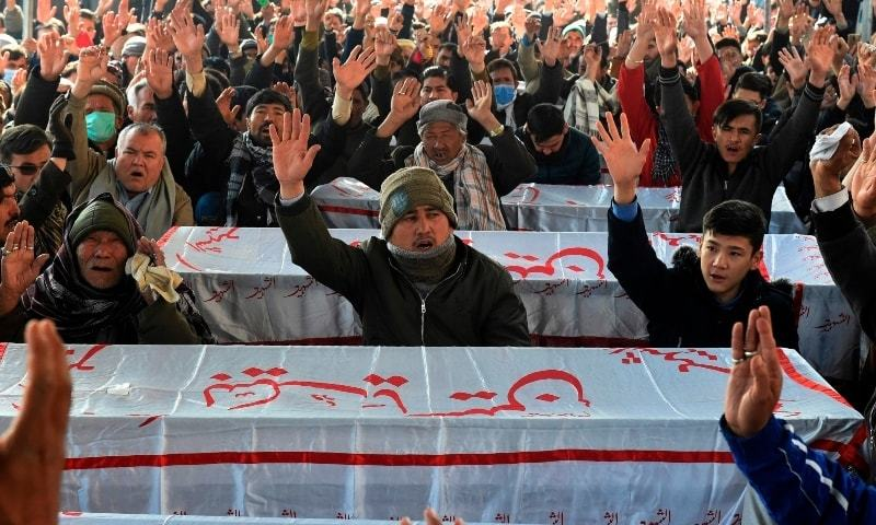 Mourners chant slogans near the coffins of the miners who were killed in an attack by gunmen in the mountainous Mach area, during a sit-in protest at the eastern bypass, on the outskits of Quetta on January 4. — AFP/File