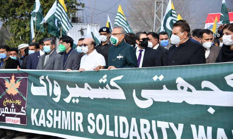 President Arif Alvi leads a march on Kashmir Solidarity Day in Muzaffarabad along with AJK PM Raja Farooq Haider and AJK President Sardar Masood Khan. — Photo courtesy: APP Twitter