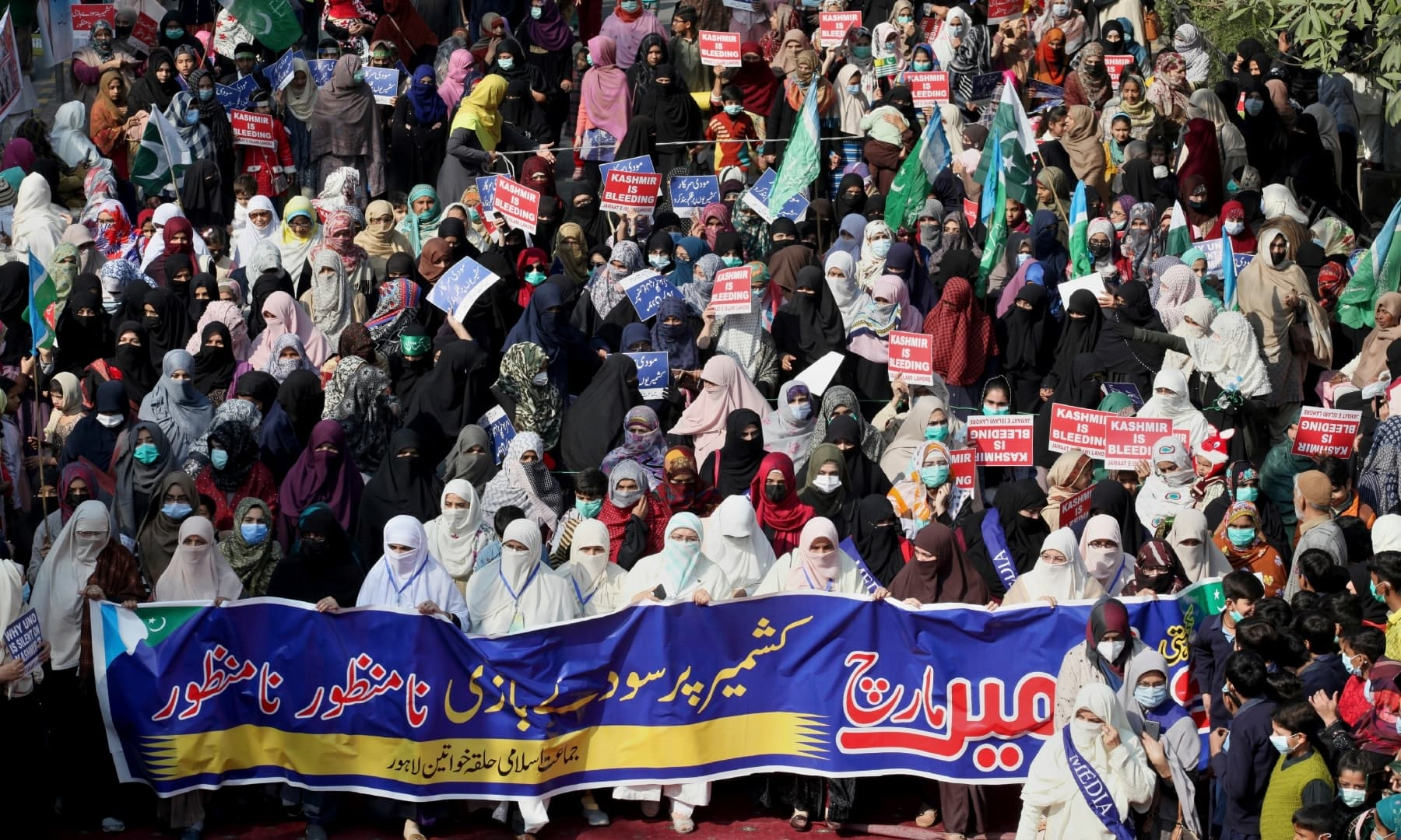 Supporters of Jamaat-i-Islami participate in a rally to mark Kashmir Solidarity Day in Lahore, Friday, Feb 5. — AP