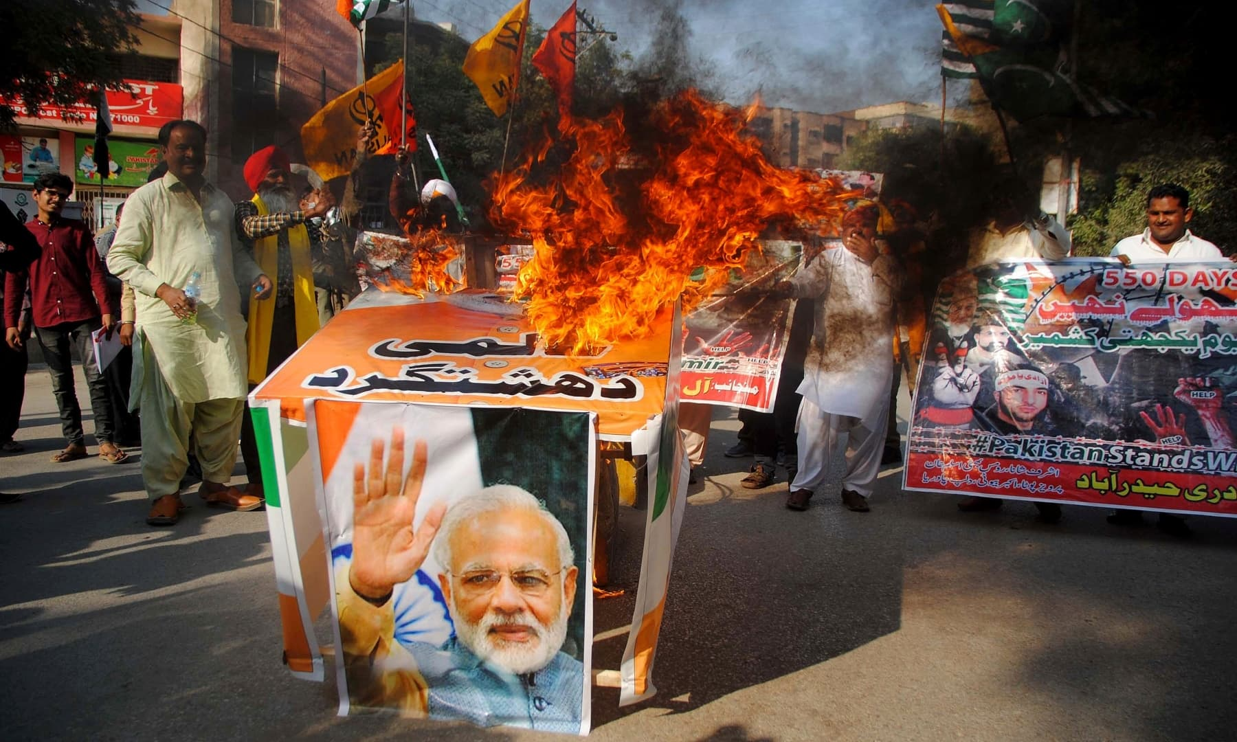 Christians burn a portrait of Indian Prime Minister Narendra Modi during a demonstration to mark Kashmir Solidarity Day in Hyderabad, Friday, Feb 5. — AP