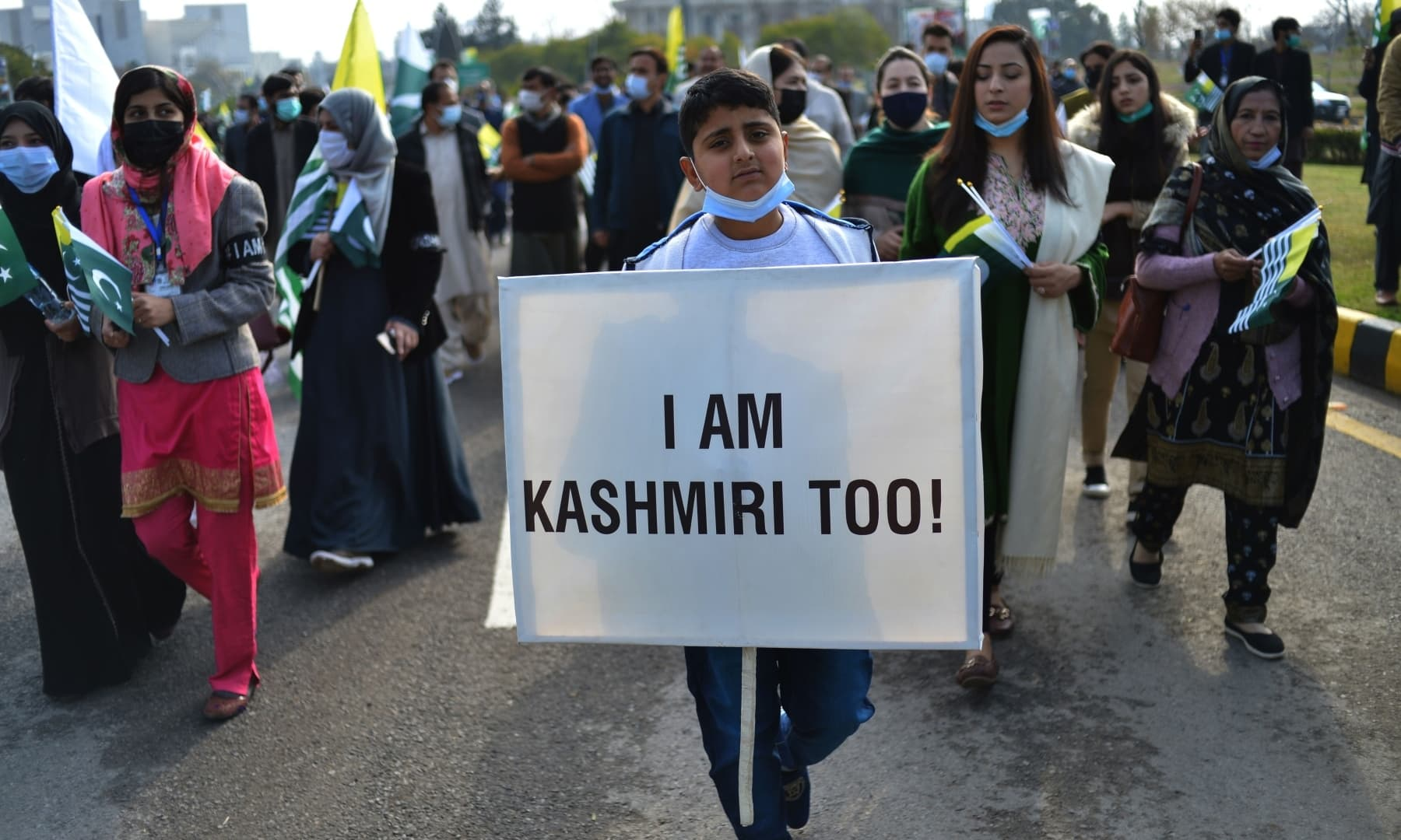 People take part in a rally to mark Kashmir Solidarity Day in front of the parliament in Islamabad on February 5. — AFP