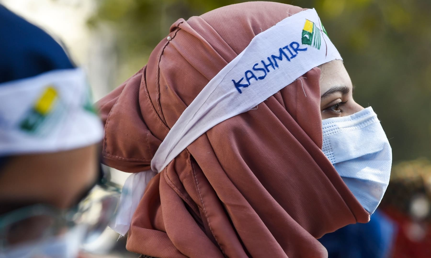 Jamaat-i-Islami (JI) activists and supporters take part in an anti-India demonstration to mark Kashmir Solidarity Day in Lahore on February 5. — AFP