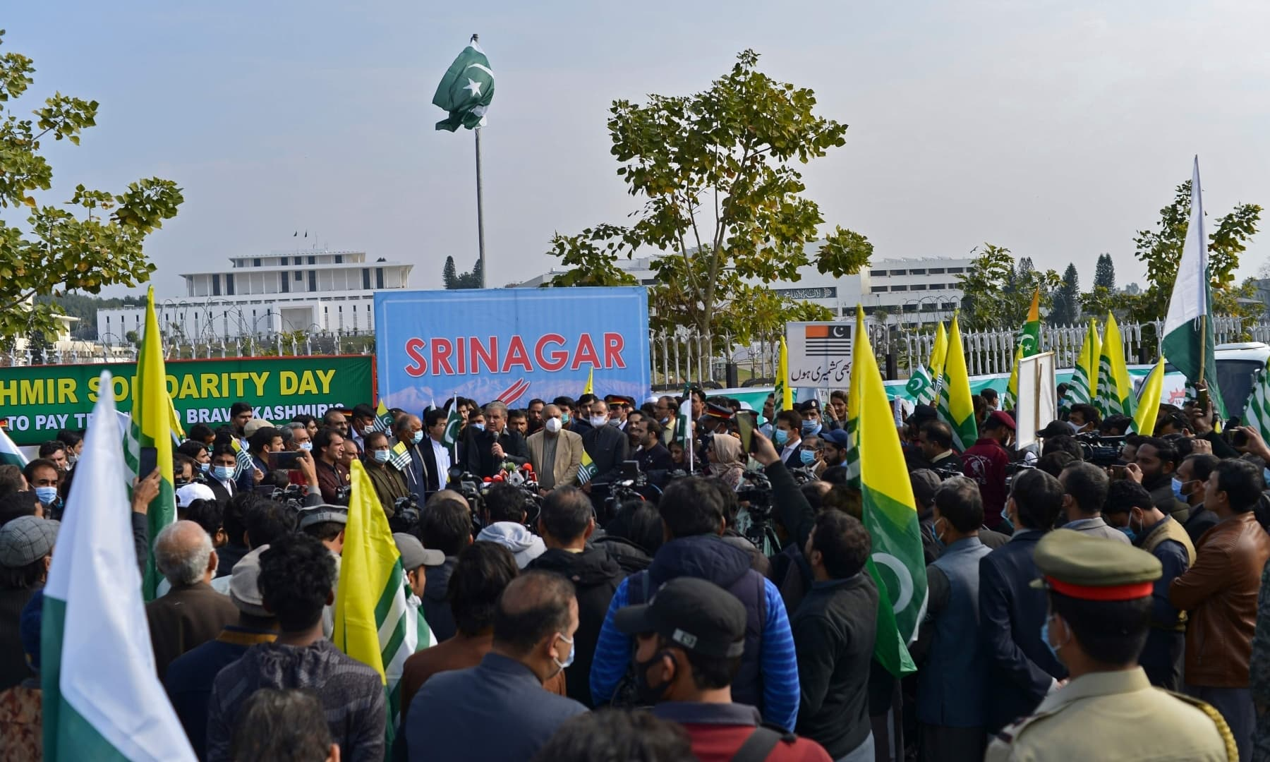 People take part in a rally to mark Kashmir Solidarity Day in front of the parliament in Islamabad. — AFP
