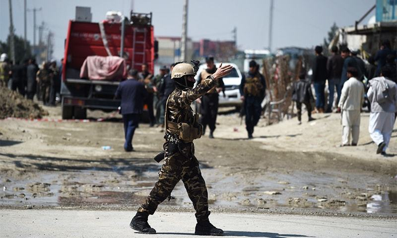 A member of the Afghan security forces secures the site of a car bomb attack in Kabul on March 17, 2018. — AFP/File