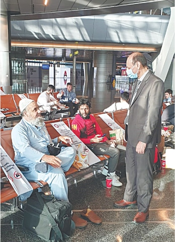 A PIA official checks in with a passenger stranded at KLIA   PIA