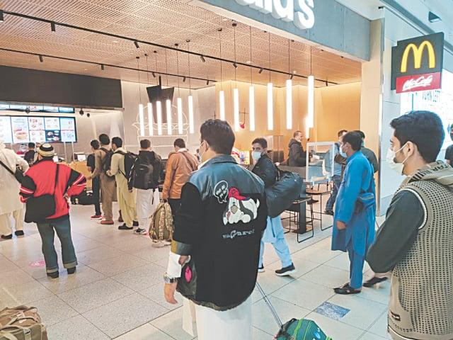 The stranded passengers line up at a restaurant at Kuala Lumpur International Airport (KLIA)   PIA