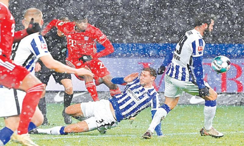 BERLIN: Bayern Munich's Kingsley Coman scores during the Bundesliga match against Hertha Berlin. —AFP