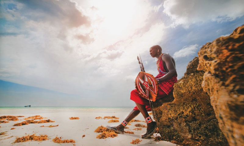 A Masai warrior in Africa in contemplation. It is absurd to rank an industrial society higher than a traditional one, since the lens from which we are viewing both belongs to the industrialised society