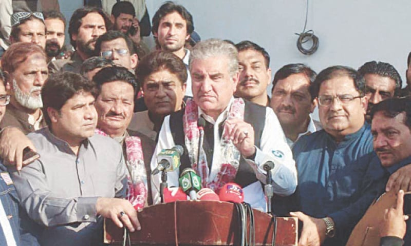 MULTAN: Foreign Minister Shah Mahmood Qureshi speaks to reporters on Sunday.—Dawn