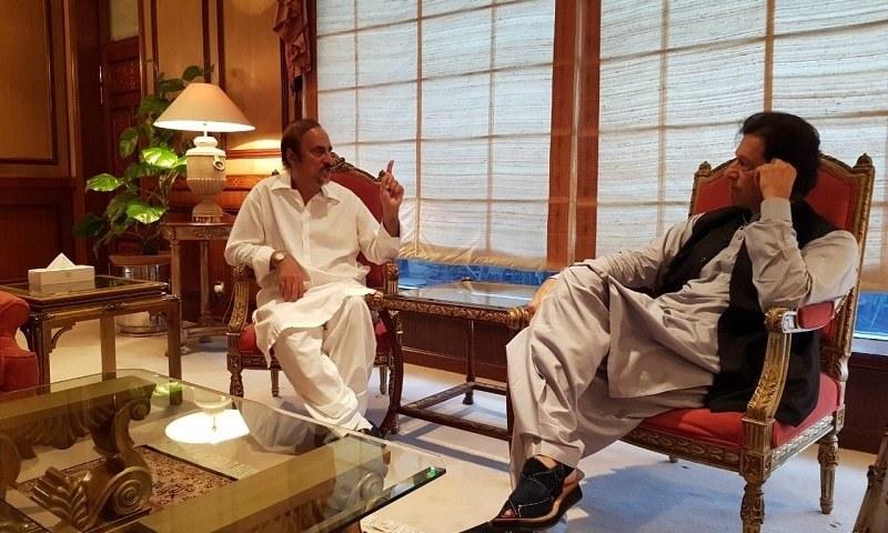 In this file photo, Babar Awan meets Imran Khan at the PM Secretariat. — Photo courtesy Fahad Chaudhry