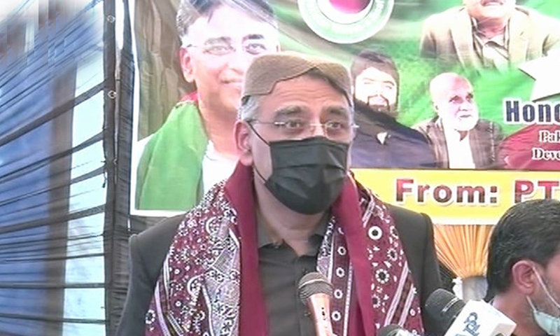 In this file photo, federal minister Asad Umar addresses a PTI workers' convention in Shikarpur. — DawnNewsTV/File